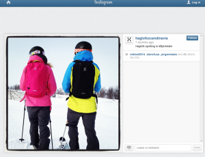 Two skiers wearing rucksacks