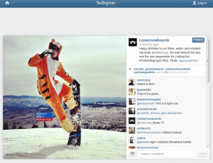 A man in a tiger suit on a snowboard